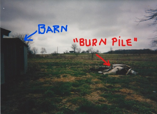3.27.2002_behind barn_burn pile_LI